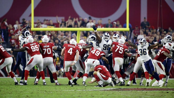 Arizona Cardinals Phil Dawson kicks a 56-yard field goal against the Los Angeles Rams in the second half on Dec. 3, 2017 at University of Phoenix Stadium in Glendale, Ariz.