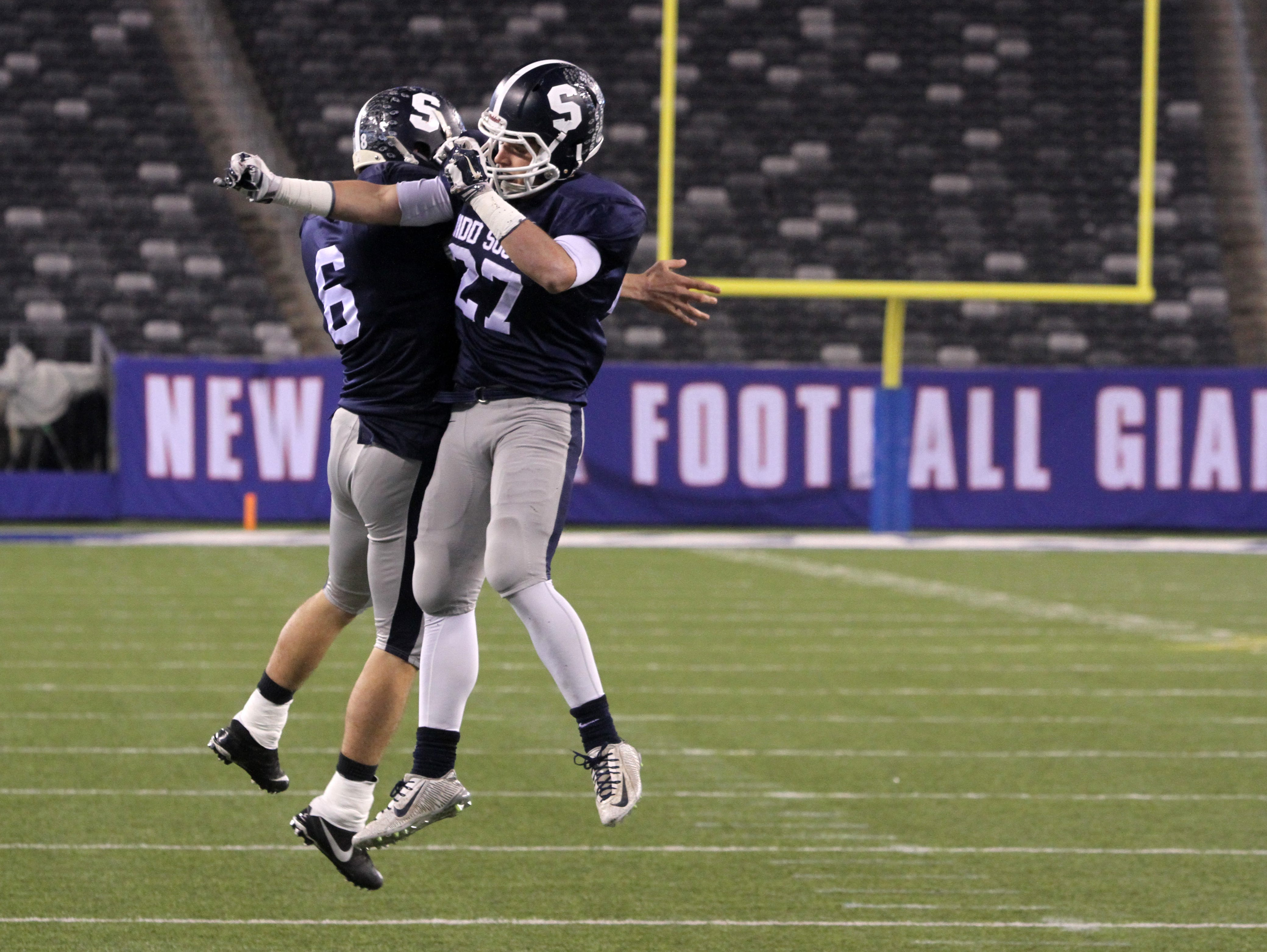 (right) Middletown South's #27 Cole Rogers celebrates his 1st quarter touchdown with (left) #6 Joel Vargas against Phillipsburg High School during the North 2 Group IV game of the 2015 NJSIAA/MetLife Stadium High School Football Championships at MetLife Stadium in East Rutherford, NJ Saturday December 5, 2015.