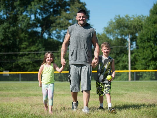 Chris Lawson, a bariatric surgery patient, walks with his daughter Avery, 4, and son Calem, 6, as they visit a park in Audubon Park late last month.