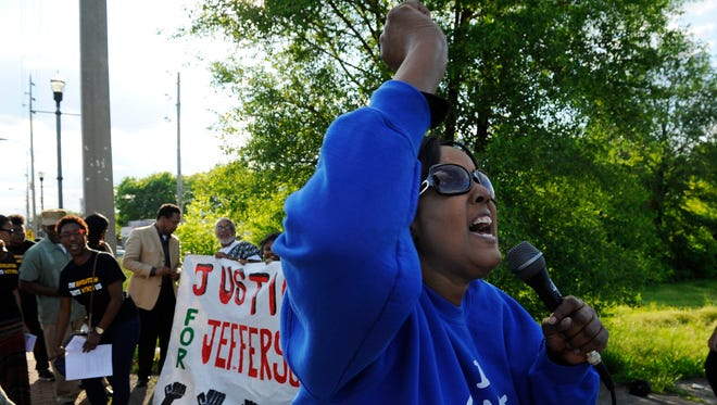 Marilyn Brown leads a chant during a rally Wednesday against the proposed police headquarters along along Jefferson Street.