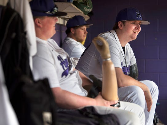 Landon Wilson laughs with teammates in the dugout during Haywood's 12-11 victory against Crockett County on April 5.
