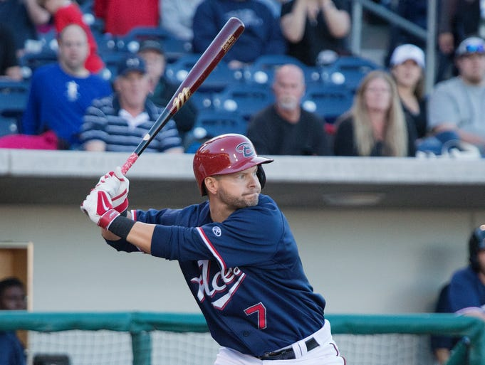 Reno Aces Cody Ross swings against the Albuquerque Isotopes at Aces Ballpark on Thursday night, April 10, 2014.