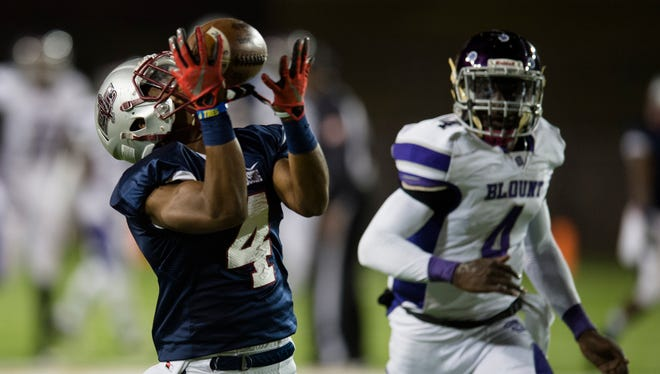 Park Crossing's Josh Knight (4) catches a touchdown pass during the AHSAA State quarterfinal playoff football game between Park Crossing and Blount on Friday, Nov. 18, 2016, at the Cramton Bowl in Montgomery, Ala.