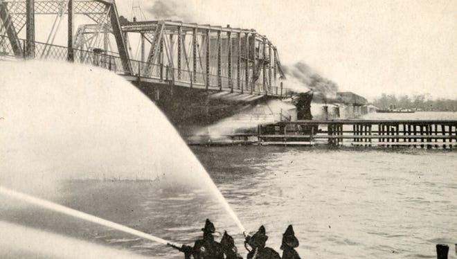 The old Belle Isle Bridge in Detroit burns down on April 27, 1915.