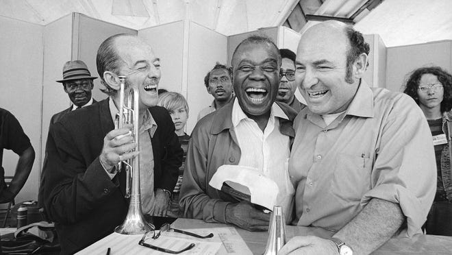 Louis Armstrong, center, joins in his own joke over an old jazz story with trumpeter Bobby Hackett and Newport Jazz Festival impresario George Wein in Newport on July 10, 1970.