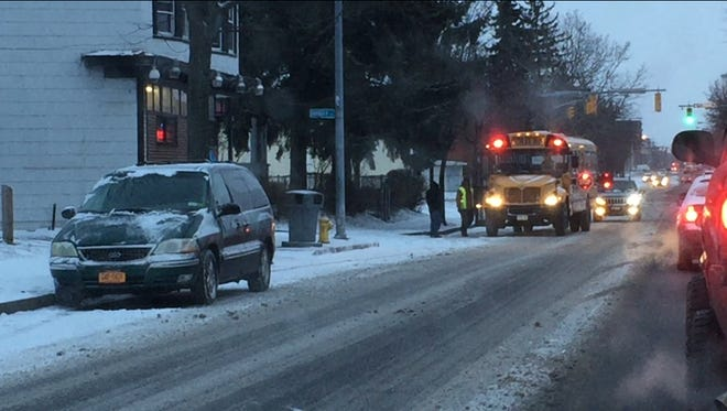 Sloppy roads slowed Wednesday morning's commute in the Rochester area, where a wind chill advisory is in effect from 10 a.m. Wednesday through 10 a.m. Thursday.