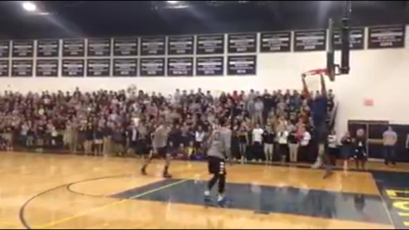 Asheville Christian Academy girls basketball coach John Williams dunks during a Tuesday pep rally at the private school.