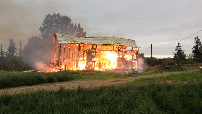 A debris fire that started about two miles north of Mt. Angel on Tuesday destroyed a 60-year-old barn.