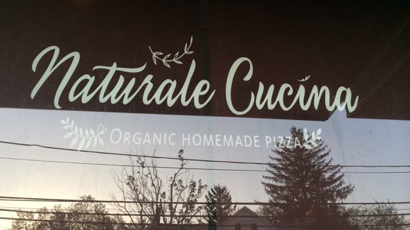The window of Natural Cucina, an organic restaurant in Englishtown.