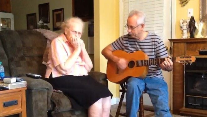 Lyndel Rhodes, 91, plays harmonica while son Buddy Cannon accompanies her on guitar.