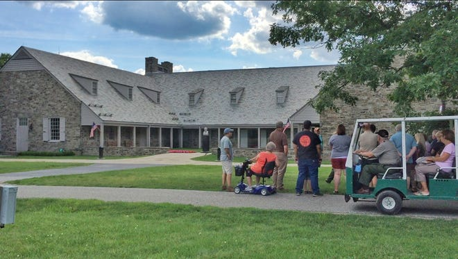A tour group looks at the Franklin D. Roosevelt Library and Museum in Hyde Park.