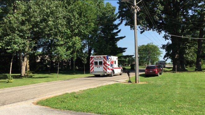 A Frankfort man managed to keep his head above water Wednesday morning after his tractor pinned him in a ditch.