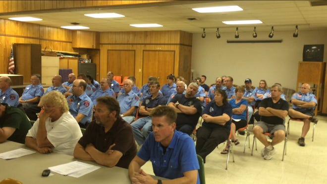 A crowd largely comprised of Campbellsport Fire Department members wait for a public hearing after alcohol was seized from the firehouse following an anonymous letter.