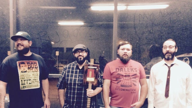 Blues band Saltwater is composed of Travis Brooks on lead vocals and guitar, Wess Hardin on guitar, Mario Teixeira on bass, and Chris Step on drums. Travis Brooks crafts all of his own guitars out of cigar boxes and sells them through his small business Mojo Factory.