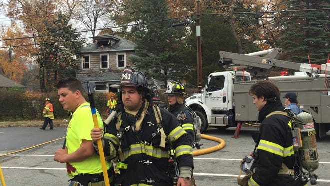 Responders at the scene of a house fire on Cedar Knolls Road in Hanover Thursday, Nov. 5, 2015.