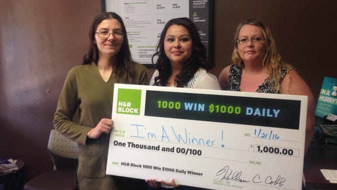 Dianna Hernandez won $1,000 with the H&R Block national giveaway. She was the first in the nation. From left to right, Jackie Miller,  Dianna Hernandez, Terri Lesmeister.