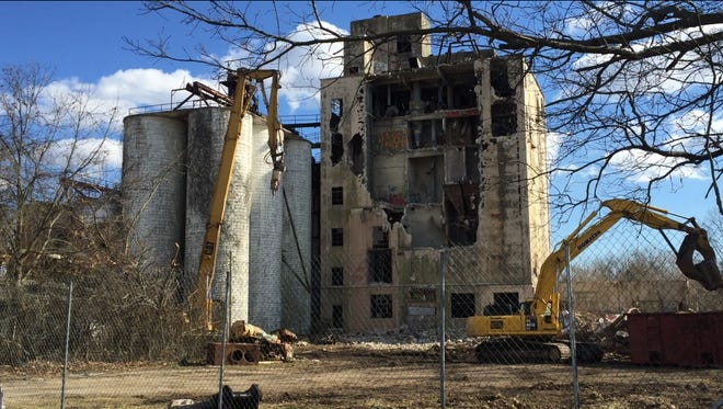 Pittsgrove Township took over this old grain mill facility at 1237 Landis Avenue  for back taxes and has worked for years to arrange its razing. That work is fully underway as of Monday.