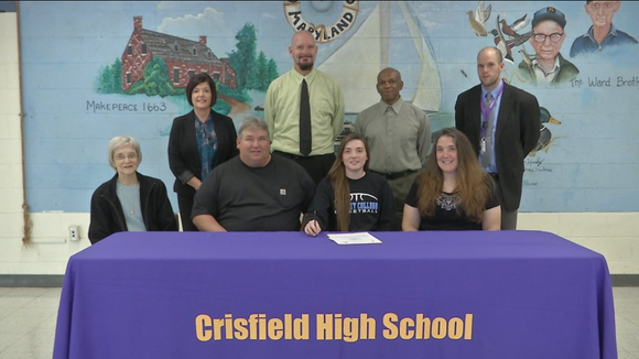 Crisfield high girls basketball player Crystal Merritt (center) committed to Division III Wesley College last week.