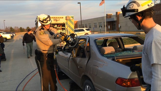 Johnson County Sheriff's Deputies demonstrate the jaws of life for the Citizen's Police Academy on Monday.