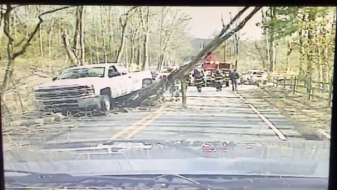 Boonton Township Police Sgt. Andrew Tintle's dash cam caught a tree falling right in front of him on Rockaway Valley Road during a wind storm on Sunday, April 3, 2016. Tintle managed to stop but his dash cam caught a truck traveling in the other direction that crashed into the tree.