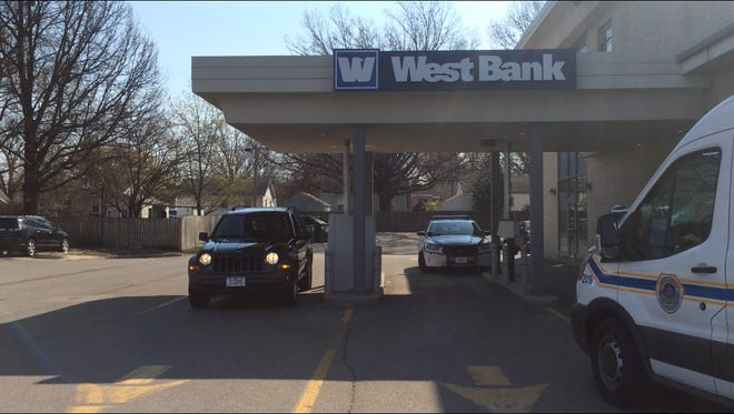 Robbers stole cash at gunpoint from West Bank at 3839 Merle Hay Road Wednesday morning.