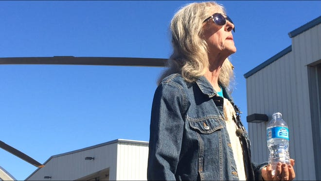 Ann Rodgers of Tucson, lost in the Arizona wilderness for nine days, speaks to reporters at the Tucson airport on April 13, 2016.