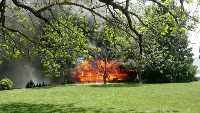 Two dogs died in an 11:40 a.m. Sunday blaze at this home in the 7300 block of Green Road in Deerfield Township.