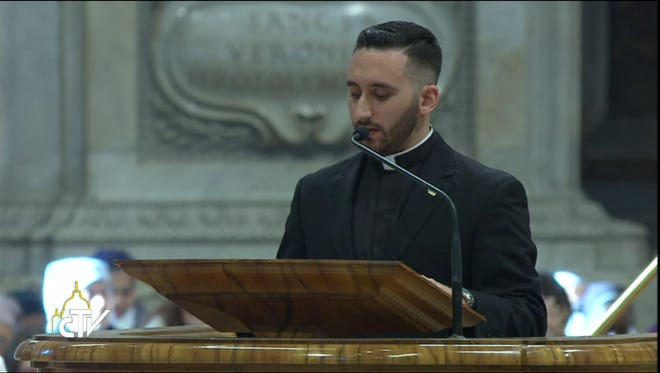Maxwell Carson, a 2012 graduate of Dowling Catholic High School, reads from scripture at Pope Francis' New Year's Day Mass in Vatican City. This photo was captured from the Vatican's recording of the Mass broadcast on YouTube.