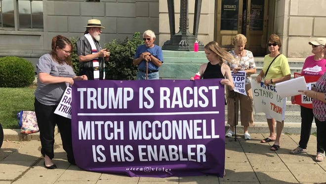 Members of ultraviolet stood outside of the Gene Snyder Federal Building Tuesday to protest Mitch McConnell.