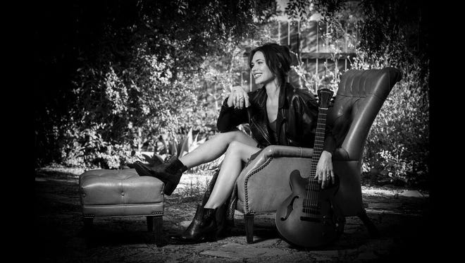 Suzanne Santo, formerly of HoneyHoney, promotes her solo career at Rootsfest Saturday.
