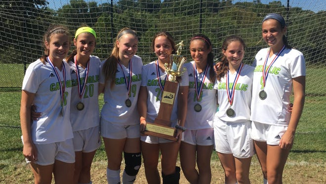Owensboro Catholic's girls soccer team, which includes seven players from Henderson, won the All A Classic state tournament last weekend in Frankfort