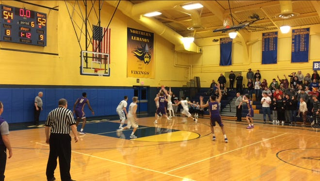 Jonny Besecker's contrversial game-winning 3-pointer - the ball appears to still be in his hand as time expires - lifted Lancaster Catholic to a 55-54 double overtime victory at Northern Lebanon on Tuesday night.