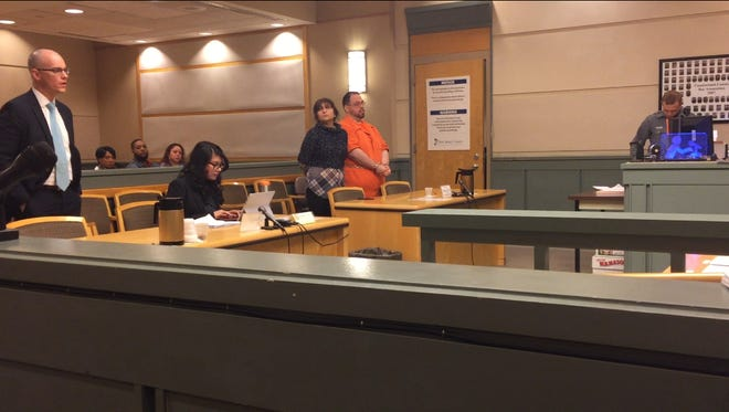 Commercial Township resident William J. Eisenhardt (jail jumpsuit) was in Cumberland County Superior Court April 9 for a  hearing on a possible plea bargain. He stands with his attorney, Dinaz Akhtar. County Assistant Prosecutor Charles Wettstein (right) represents the state.