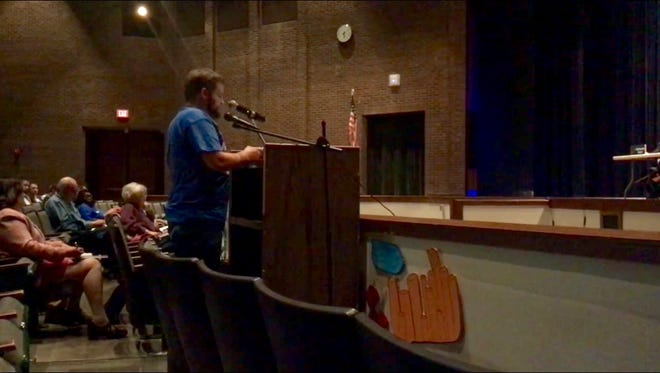 An Indianapolis Power & Light customer and pastor in the city speaks at the April 23 public hearing against the utility's proposed rate increase.