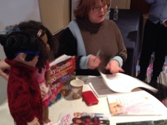 Nicky Epstein was signing books at the marketplace.in