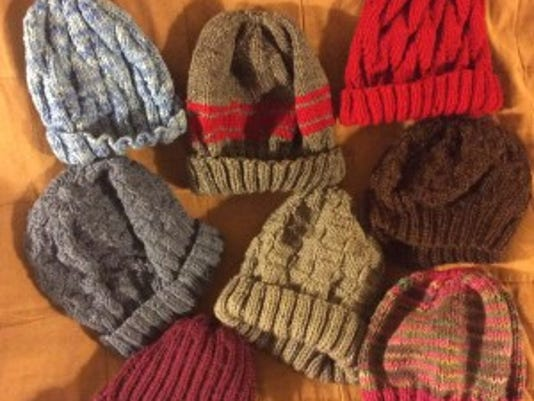 Here are my eight hats for homeless people and veterans. I already gave Pete his new green hat.