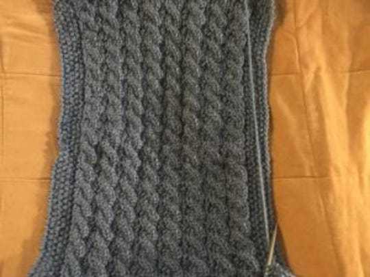 This is the reversible cable scarf I'm working on right