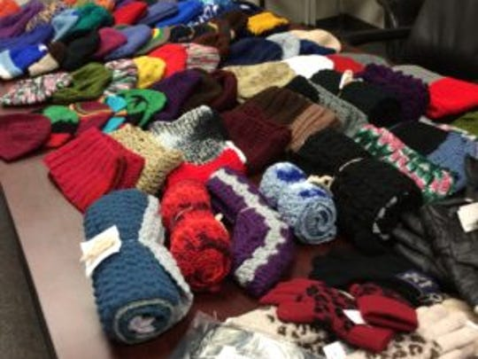This is a photo of the 63 hats and more than 20 scarves
