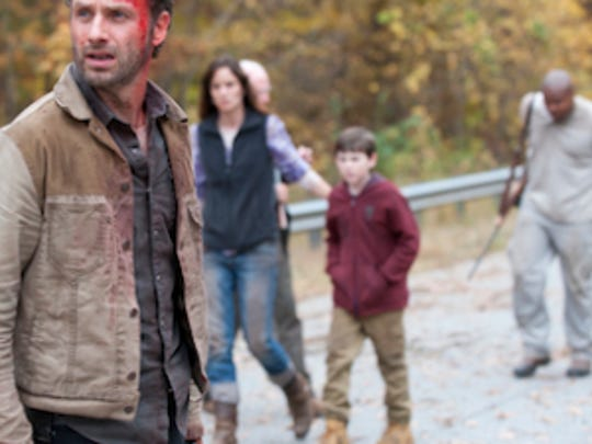 "AMC says it will ""reevaluate"" its activity with ""The Walking Dead"" in Georgia if a new abortion law goes into effect."