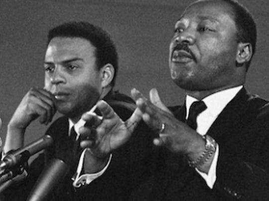 In this Feb. 7, 1968 file photo, Dr. Martin Luther King Jr., center, speaks to an audience. King, who was president of the Southern Christian Leadership Conference, is shown with the Rev. Andrew Young, executive Vice President of the Southern Conference. Veterans of past social movements, such as Young, say the Occupy Wall Street protest has been a welcome response to the abysmal economy and has the potential to galvanize wide support.