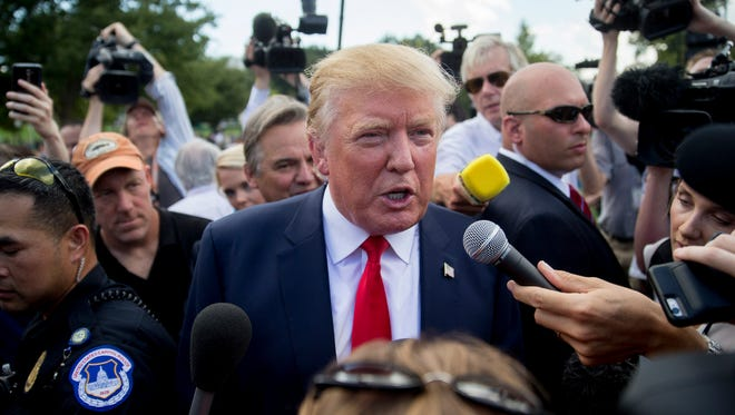 Donald Trump talks to the news media after speaking during a Tea Party Patriots rally against the Iran nuclear deal on Capitol Hill in Sept. 9, 2015.