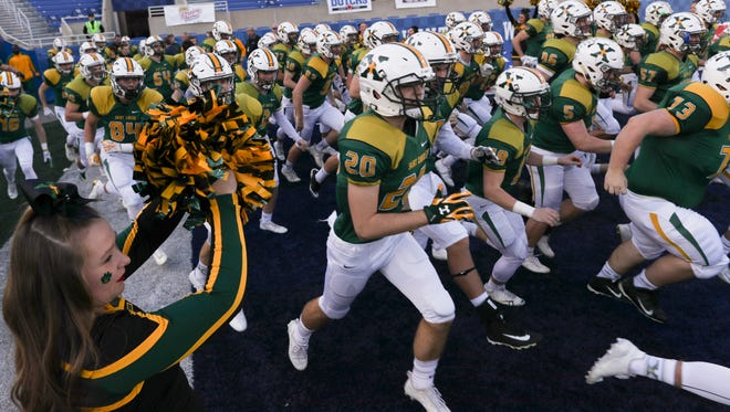 St. Xavier takes the field at the start of the Commonwealth Gridiron Bowl held at the UK football stadium on Sunday afternoon. Dec. 3, 2017