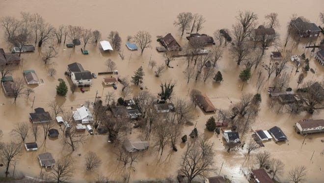Homes in Utica, Ind. sit submerged in the floodwaters of the Ohio River on Feb. 25, 2018.