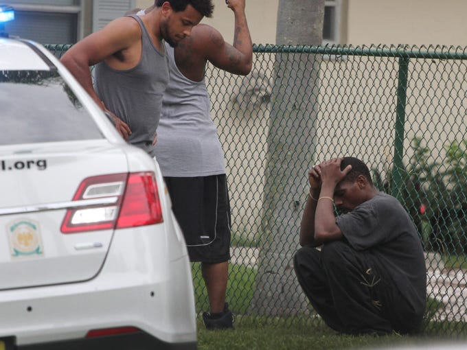 Residents react after a shooting in North Fort Myers