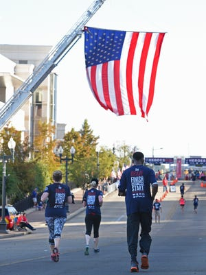 People run in the inaugural Brookshire's and Super 1 Foods Heroes Run in downtown Shreveport in this file photo.