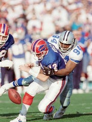 Jim Kelly has the ball stripped by the Cowboys' Charles Haley during first quarter.
