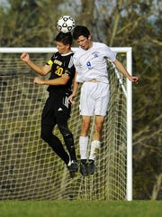 Harwood's Jonathan Zacharias, left, and Lake Region's Matt Lawlor duel for a header during the second-seeded Rangers' 3-0 win over the third-ranked Highlanders in a Division II soccer semifinal on Wednesday, Nov. 2, 2016. (Photo by Michael Beniash)