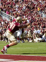 Florida State redshirt junior tight end Ryan Izzo hauls