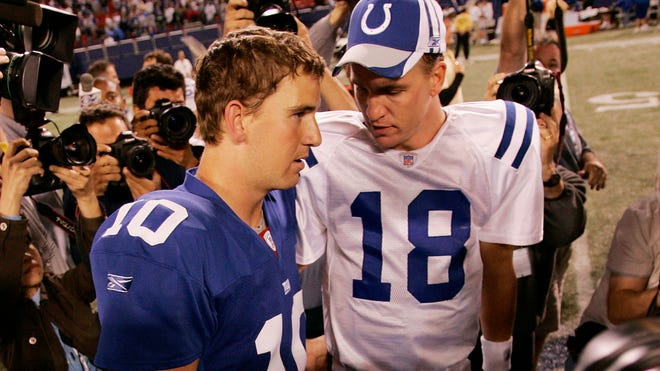 Eli (left) and Peyton Manning greet each other after an Indianapolis-New York Giants game in the East Rutherford, N.J. on Sept. 10, 2006.