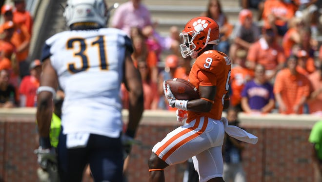 Clemson running back Travis Etienne (9) scores against Kent State during the 4th quarter on Saturday, September 2, 2017 at Clemson's Memorial Stadium.